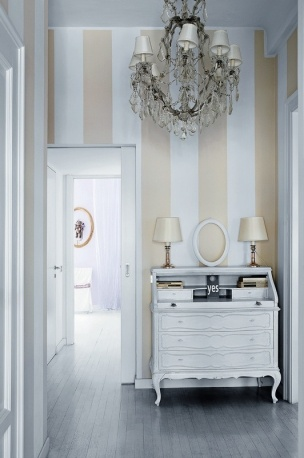 Wide stripes like these with the orante, curvy French furniture and chandelier are always a style hit.