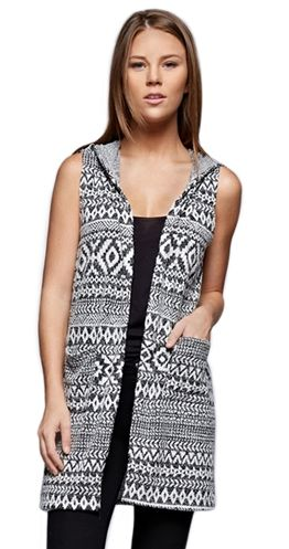 "Looking to achieve that layered look but don't know where to start? The ""Lodge-ical"" choice is this soft and cozy vest. Not only is it super cute but it adds an extra layer of warmth without the bulk of sleeves.  Soft and fuzzy Cardigan vest Hood Longer Length Front pockets Aztec Pattern Made in USA"