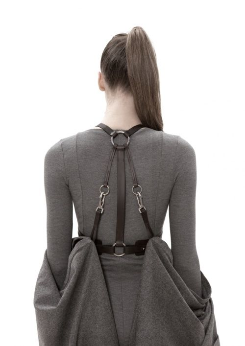 Visions of the Future: Leather Harness Dress with soft sculptural draping -  dress back close up;