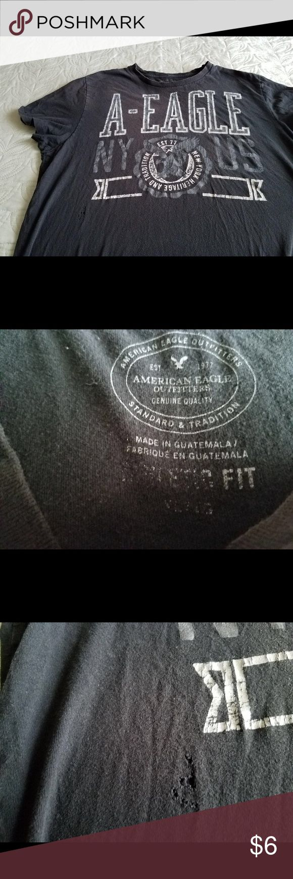 American eagle tshirt American eagle t shirt size xlarge does have a few small holes in the front I took a picture of them other than that great condition American Eagle Outfitters Shirts Tees - Short Sleeve