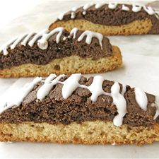 Black and White Biscotti (butter, sugar, salt, baking powder, vanilla, eggs, cocoa, expresso powder, choc chips, icing sugar)