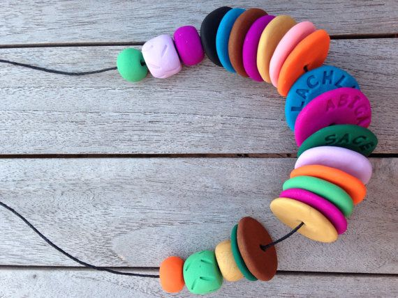 Personalised Rainbow Discs necklace, stamped with the customers three children's names on the inside of three disc beads.