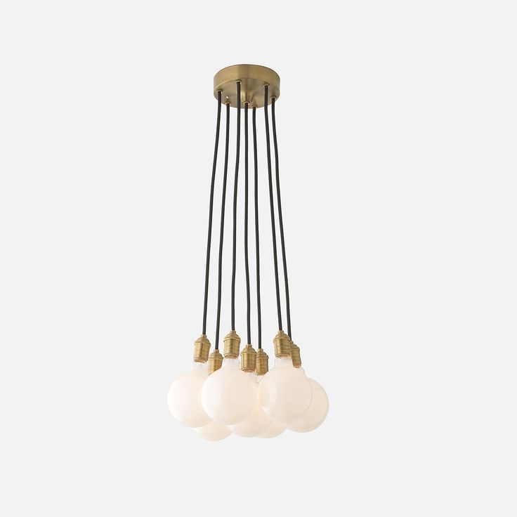 A celebration of midcentury American design, the Brass City Chandelier's clean lines and exposed, natural brass hardware showcases the luminous beauty of lit bulbs. Whether it's a bouquet of filaments or a cluster of frosted orbs, this modern, industrial chandelier is an ode to pure, unfettered light.  The Brass City Chandelier is handcrafted to match the quality and durability of original classics with exclusive parts made of hand-spun metal and finished in our state-of-the-art shop. Once…