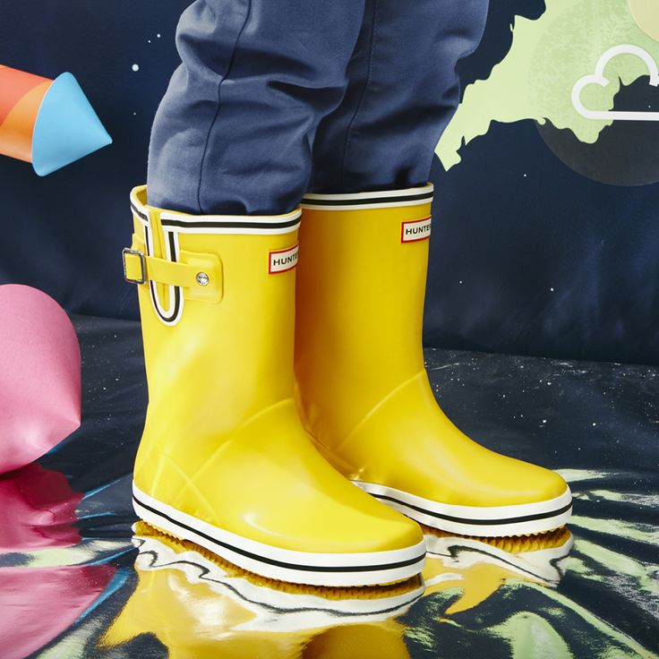Original Kids Flat Sole Buoy Stripe Wellington Boots | This handcrafted kids' boot, features a nautical stripe print and forms a smaller version of the iconic adult boot. An adjustable gusset adapts fit and a flatter sole ensures this style is easier to walk in.