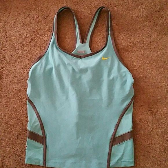 """Nike Tiffany Blue YOGA RUNNING TANK TOP Shelf Bra Like new.. worn once.. Nike Sports Top with built in shelf/sports bra. Sz S Tiffany Blue color. Under armpit to under armpit 15"""" Length from shoulder to end of top 21"""" Nike Tops Tank Tops"""
