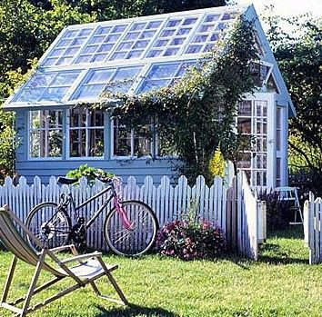 greenhouse shed with bike and picket fence.. love the old windowed up roof!