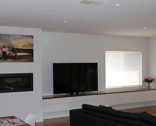 Custom built wall unit 2-Pak painted white gloss with timber benchtop. Jetmaster fire place  wall