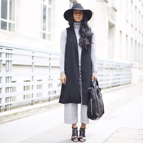 5 Reasons To Go Sleeveless This Fall, If Only For Your #OOTD #refinery29  http://www.refinery29.com/how-to-wear-a-vest#slide4  Instantly add length to your ensemble with a sleeveless duster, like Monikh Dale's.