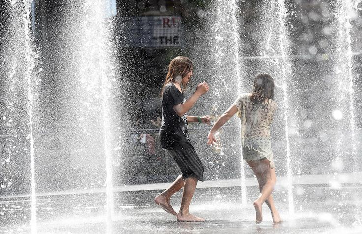 Two girls playing in a fountain  Piazza Gae Aulenti, Milano