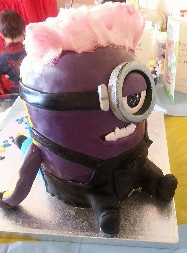 Double Minion Cake. One side yellow and other side purple with candy floss hair.