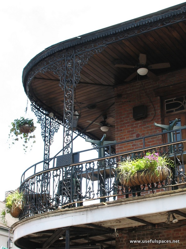 Love the contrast between the detailed metal work and the wood soffits.