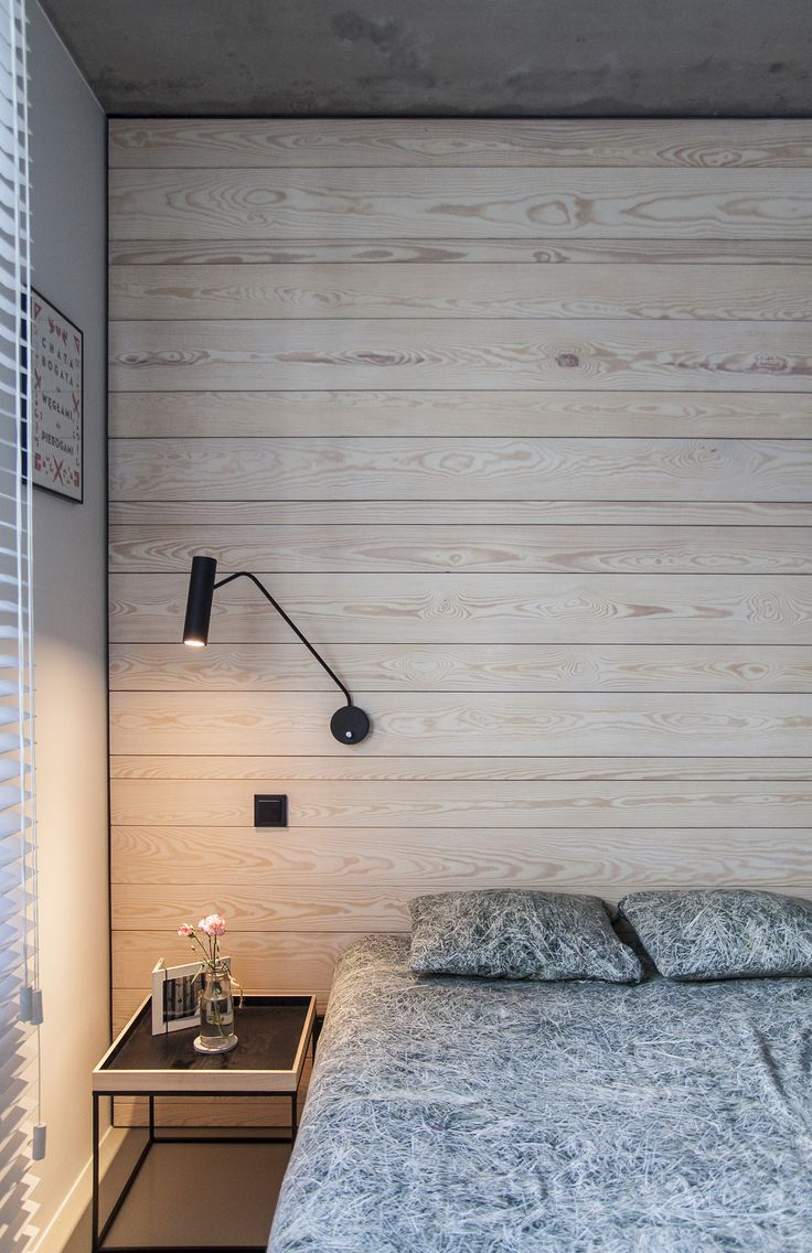 mieszkanie własne w Gdyni - PRACOWNIA 111  minimalistic scandinavian bedroom with raw pine planks on the wall