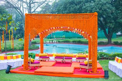 floral mandap decor, genda phool decor, outdoor decor, near swimming pool decor