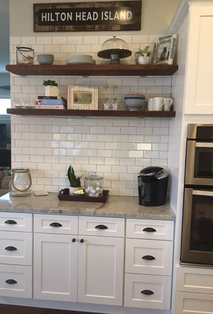 ( Wallace Kitchen AFTER)- White Shaker Cabinetry, Granite: Thunder White, Hand-scraped hard Maple floors in Hemlock, Backsplash:3X6 Subway Tile with a Pewter Grout