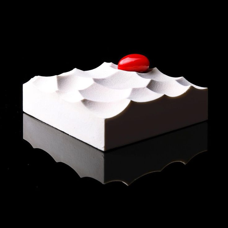 """Ukrainian pastry chef Dinara Kasko draws inspiration from her background as an architect and designer to produce these awe-inspiring geometric desserts. The create this visual feast she incorporates experimental methods as well as 3D modeling and printing techniques. """"In my creations, I've used such geometric constructing principles as triangulation, the Voronoi diagram, biomimicry. Biomimicry is using the models, systems, and elements of nature, macro elements in general. It can be anyth..."""