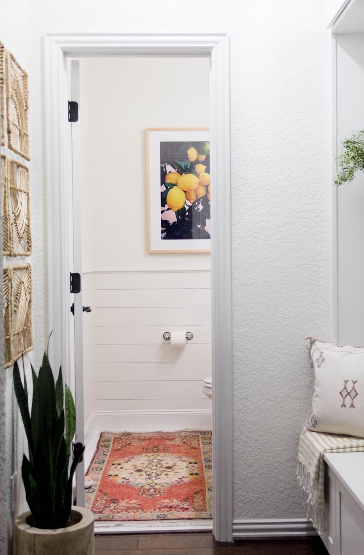 A Bright And Welcoming Mudroom Powder Room Combo With Modern Casual Beach