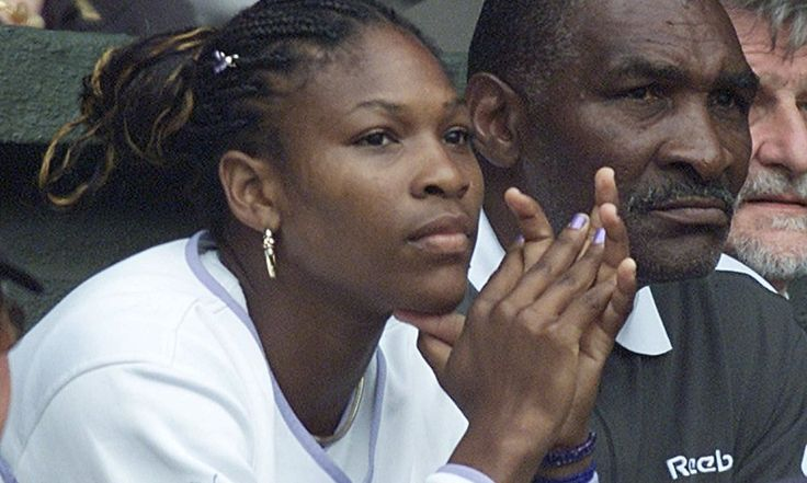 Serena Williams accompanied by her father Richard, watches the Women's Singles quarterfinal between her sister Venus and Switzerland's Martina Hingis on the Centre Court at Wimbledon, Tuesday, July 4, 2000. Serena had already reached the semifinals, by beating Lisa Raymond. (AP Photo/Dave Caulkin) ORG XMIT: XWIM125