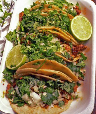 ??Tacos al pastor. These guys are filled with really yummy pork, cilantro, onion and pineapple!.