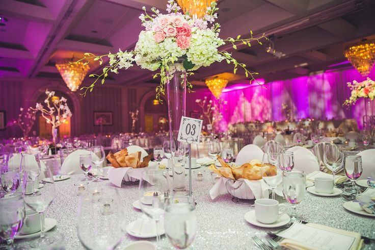 Fantastic pink and white floral and sparkly table wedding decorations! At the Carriage House Inn in Calgary. By Calgary wedding photographer Anna Michalska Photography