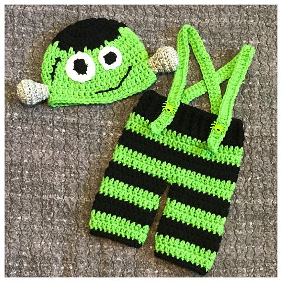 Crochet Frankenstein costume. This sweet set is Size newborn. It should fit a baby up to 10lbs. This set includes: -A Frankenstein face hat with silver bolts on each side. -A pair of black & green striped pants with green suspenders & green spider buttons. Perfect little outfit for a Halloween baby, little babes newborn pictures or as a baby shower gift. This set along with everything else in my shop is ready to ship. If you have any questions, please do not hesitate to ask. -Ca...