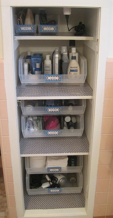 Bathroom linen closet organization and storage solutions for the home. Beautiful designs and labels.