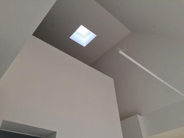 Office, white interior, LED light, minimal design.