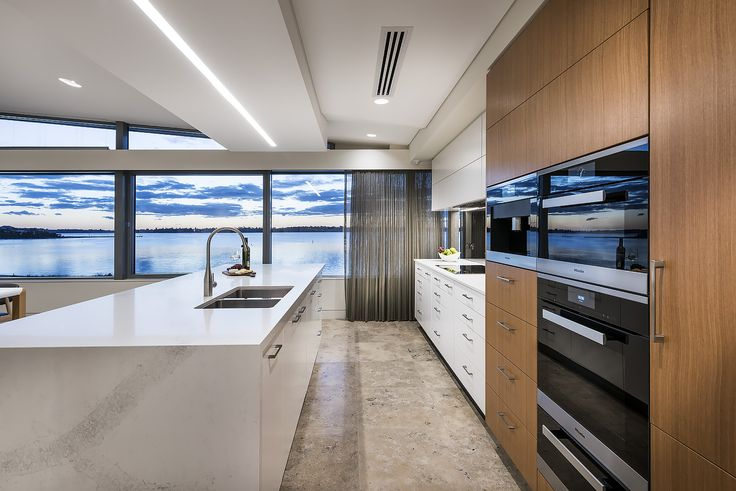 Timber veneer/ white cabinetry in a kitchen with a view. Designer: Greg Davies Architects, Builder: Urbane Projects