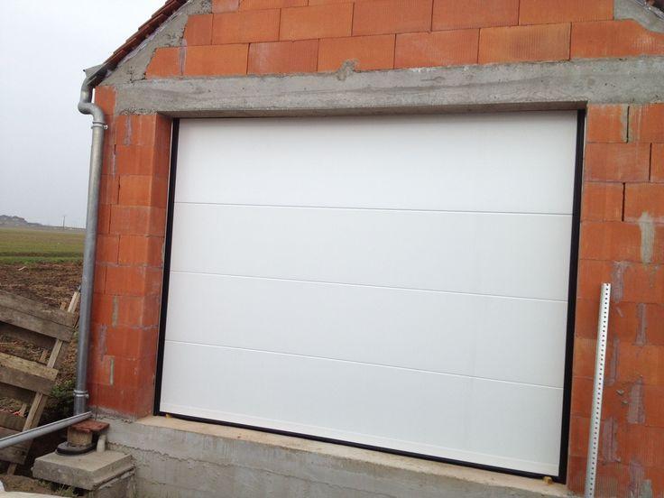 Motorized Sectional Garage Door Smooth Panels White Porte De Garage Sectionnelle Motorisee Panneaux Lisses Blancs Sectional G Sectional Garage Doors Garage Doors White Paneling
