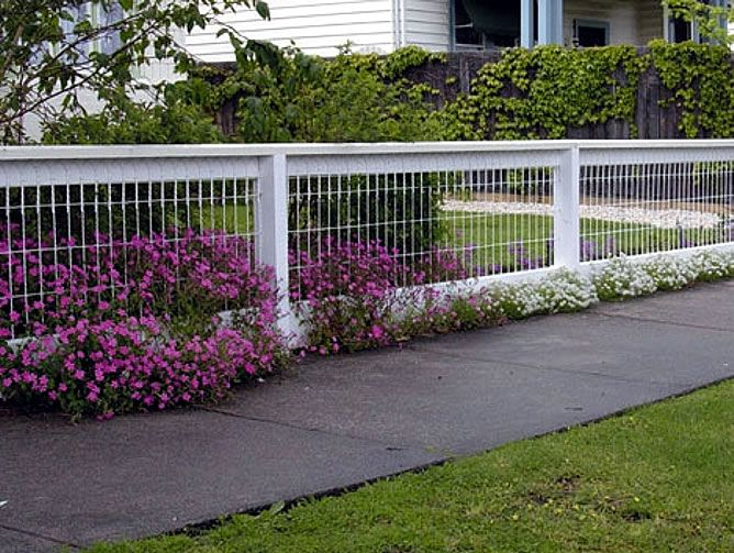 This fence is kind of what I'm looking to do around our front yard... doesn't block the beautiful view and keeps the grandchildren and puppies safe and out of the road. Would rather have a natural wood stain instead of the white painted look, though.