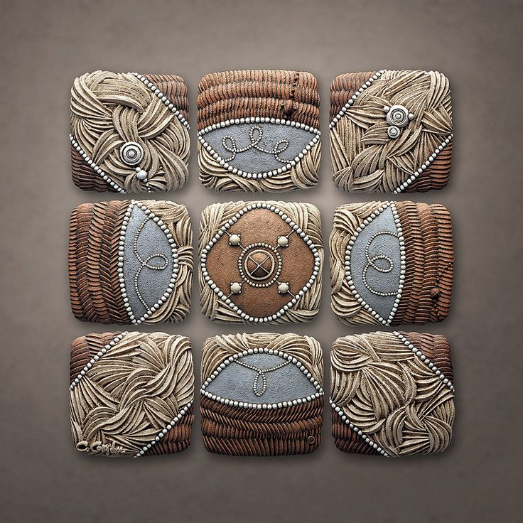 Mountain Pattern by Chris Gryder Ceramic bas relief panels 38in x 38in x 2in.