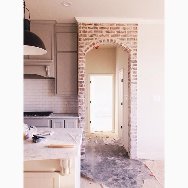 Love the Old-World appeal of the overgrouted brick arch.