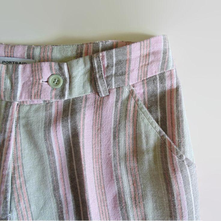 Linen high waist pants with pastel color vertical stripes.