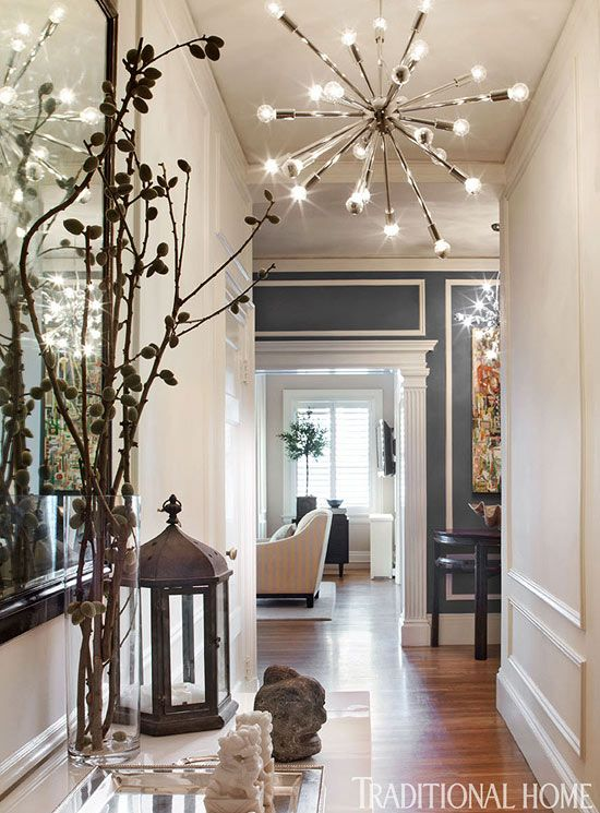 I'm in love with the chandelier!  The wall in the distance uses paint and molding to bring more visual interest into the space. {seen in traditional home}