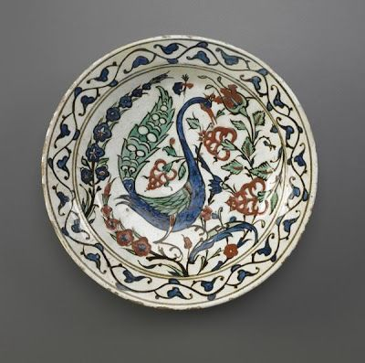 Plate | Origin:  Iznik,  Turkey | Period: late 16th-early 17th century  Ottoman period | Details:  Not Available | Type: Stone-paste painted under colorless glaze | Size: H: 6.0  W: 28.1  cm | Museum Code: F1972.4 | Photograph and description taken from Freer and the Sackler (Smithsonian) Museums.