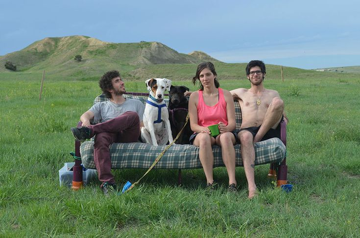 Three friends (and two dogs) who took a summer roadtrip across North America together came up with a novel way to keep track of the many beautiful landscapes they saw. When they posed for photos, they dragged their van's futon out to the most picturesque locations they could find to create a photo series that is both beautiful and silly.