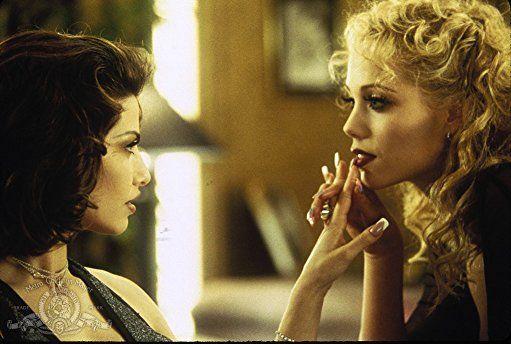 Gina Gershon and Elizabeth Berkley in Showgirls (1995)