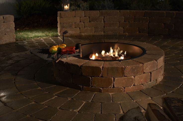 A #firepit to keep you warm and cozy in the harsh winters. Get your's installed and ready to go with attractive #outdoor #lights. http://southernlightsofnc.com/landscape-services-in-greensboro/