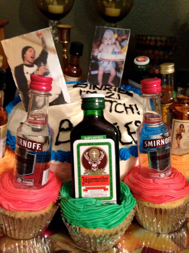 "Best friends 21st birthday. Top says ""from binkies to bottles"" -- assorted cupcakes with mini alcohol bottles"