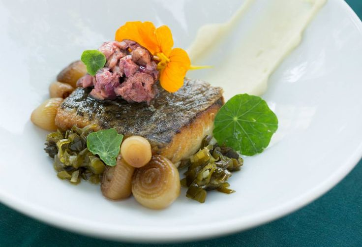 Seabass, burned onion, green onion relish, black olive http://tenbompas-restaurant.co.za/
