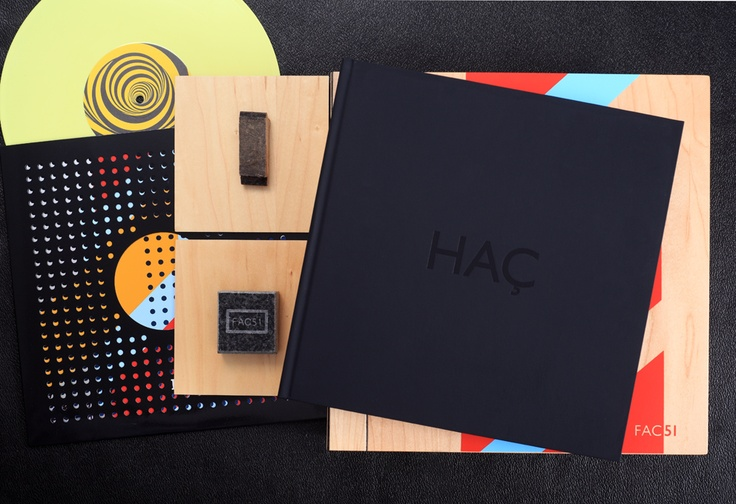 """The Deluxe Edition of the Foruli signed limited edition of 'The Hacienda: How Not to Run a Club' by Peter Hook of Joy Division and New Order. Includes genuine pieces of the maple floor and the granite bartop from the club, plus an exclusive 10"""" yellow vinyl EP and art print hand signed by Peter Hook. Only 100 copies. Design by Andy Vella and Russell Hrachovec."""
