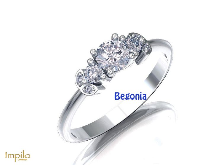"""""""Begonia"""" - This floral trilogy design has one round brilliant cut diamond centre stone with smaller diamonds on either side, and two diamonds in a pattern on each shank."""