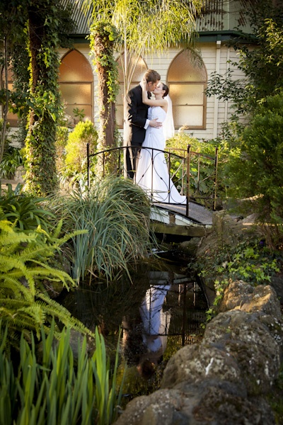 Wedding Photography at Bram Leigh Receptions couple on bridge behind chapel