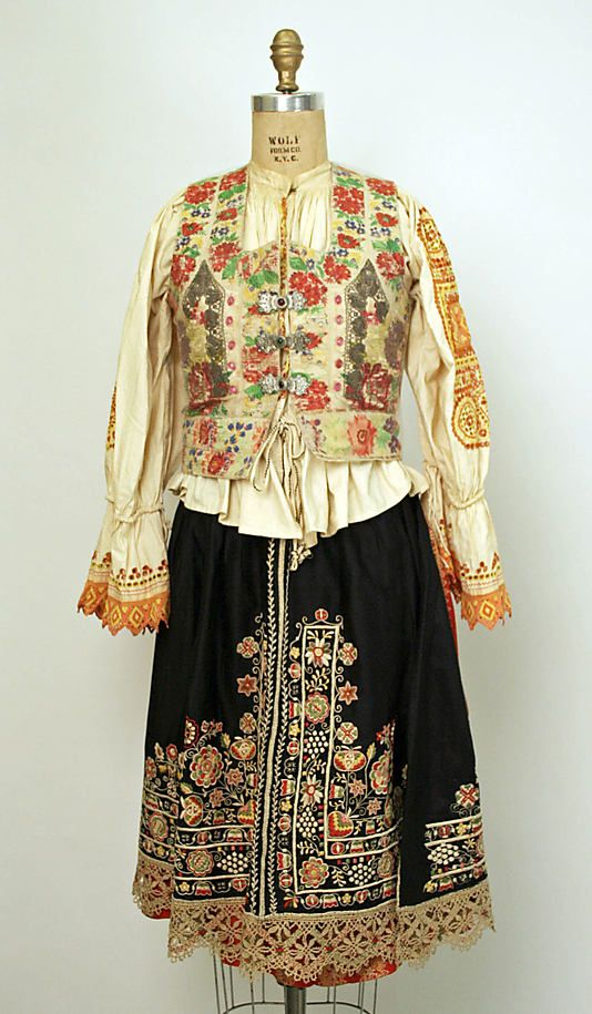 Eastern European ensemble c. 1800 - 1955. Silk, cotton, wool. Rear view. Slovakia