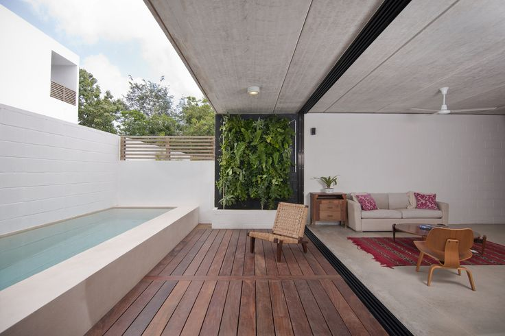 Built by JC Arquitectura in Cancún, Mexico with date 2011. Images by Wacho Espinosa. Housing solution for a typical suburban family house plot.  This house was designed for a young family, the main idea...