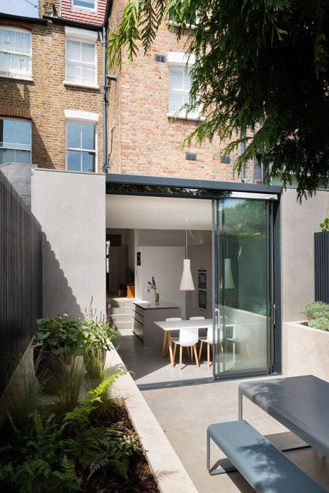 Light-filled house extension in London created with polished materials.
