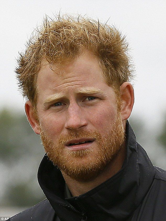 Looking tanned after a summer spent working on conservation projects in Africa, Prince Har...
