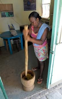 Garifuna woman carrying on a culinary legacy - Making Hudut - Beating the plantain