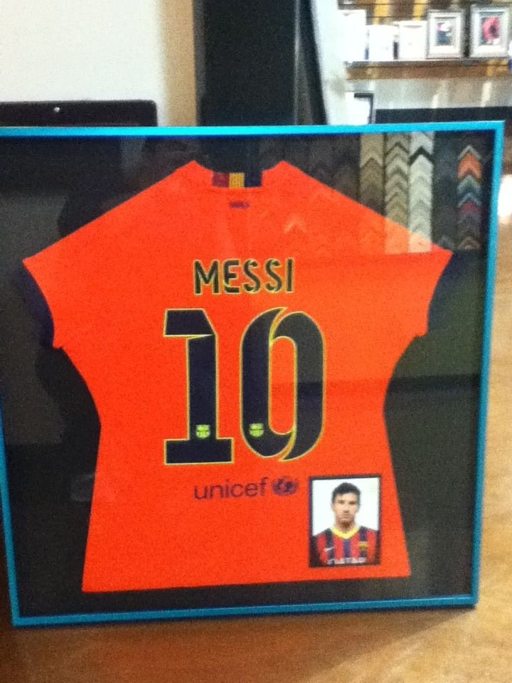 Framed Messi Soccer Jersey. This is custom metal shadowbox frame, this frame adds a fun color pop to the project and we added a framed photo of Messi to the box to give it a personal touch. www.framingestablishment.com #customframing #shadowbox #sports #soccer #messi #framing #giftideas @larsonjuhl