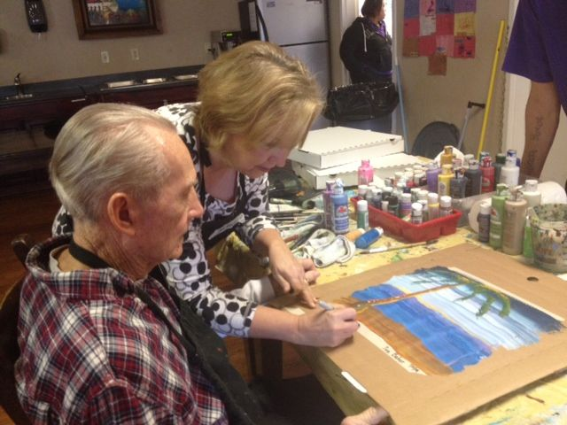 "Art Without Boundaries Dana Warwick assists resident Cliff Baker in making a beautiful piece of art entitled ""Myrtle Beach"""