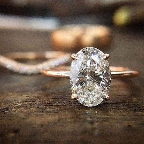 This is so perfect. I love the wedding band in the background - the kind that curve to fit perfectly around the stone  #Diamonds